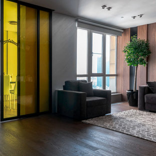 Inspiration for a contemporary living room in Los Angeles with brown walls, dark hardwood flooring and brown floors.