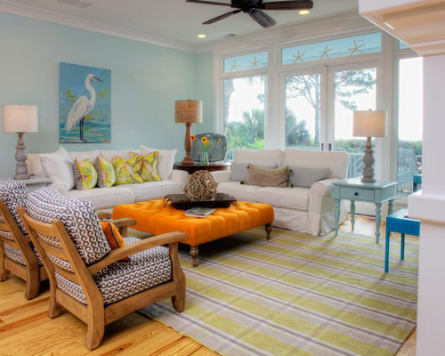 Exceptionnel Inspiration For A Beach Style Medium Tone Wood Floor And Brown Floor Living  Room Remodel In