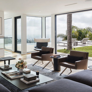 Example of a minimalist formal beige floor living room design in Los Angeles with white walls and no tv