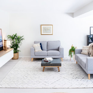 Photo of a contemporary formal open concept living room in Brisbane with white walls, no tv and beige floor.