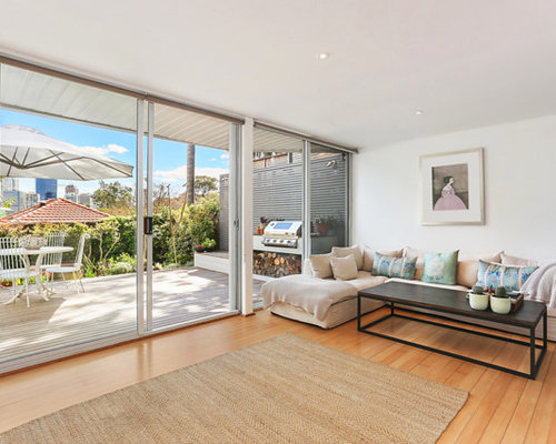Inspiration For A Contemporary Living Room In Sydney With White Walls,  Medium Hardwood Floors,
