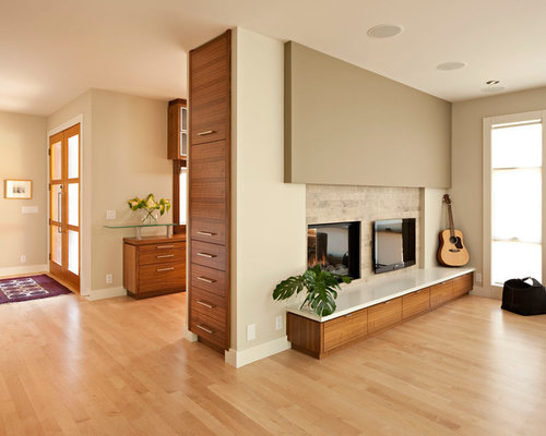 Minimalist Light Wood Floor Living Room Photo In Calgary With Beige Walls  And A Two
