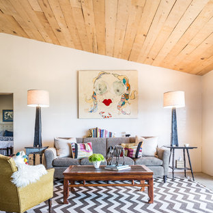 Example of a country open concept living room design in Albuquerque with white walls, no fireplace and no tv