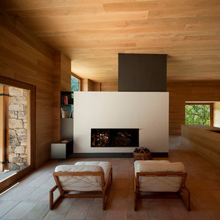 This is an example of a medium sized modern formal open plan living room in Barcelona with brown walls, terracotta flooring, a standard fireplace, no tv and a plastered fireplace surround.