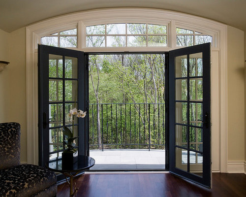 Retractable door screens on living room french doors for Hidden screens for french doors