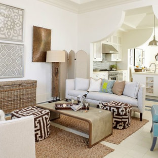Living room - beach style formal and open concept living room idea in Atlanta with white walls