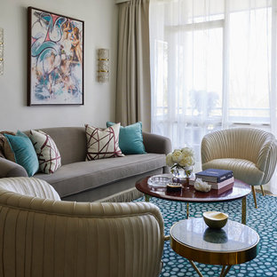 Design ideas for a mid-sized eclectic formal enclosed living room with white walls, carpet, a concealed tv and turquoise floor.