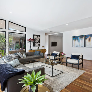 Design ideas for a mid-sized contemporary formal open concept living room in Melbourne with white walls, medium hardwood floors, no fireplace, no tv and brown floor.