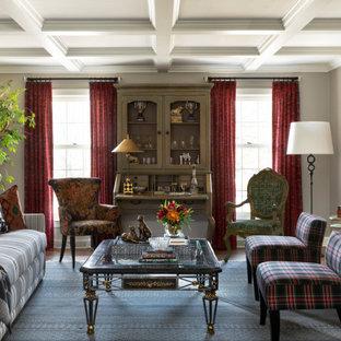 Cette photo montre un salon chic de taille moyenne et fermé avec un mur gris, une cheminée standard, un manteau de cheminée en brique et un plafond à caissons.