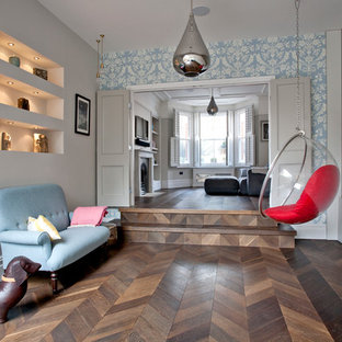Inspiration for a classic open plan living room in Surrey with dark hardwood flooring and brown floors.