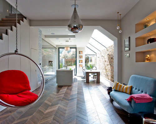This Is An Example Of A Contemporary And Modern Open Plan Living Room In Surrey With
