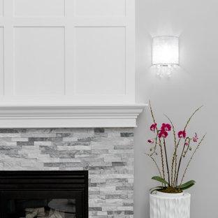 Imagen de salón abierto y panelado, actual, de tamaño medio, panelado, con paredes grises, chimenea tradicional, marco de chimenea de piedra y panelado