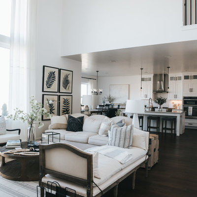 Living room - country dark wood floor and brown floor living room idea in Salt Lake City with white walls