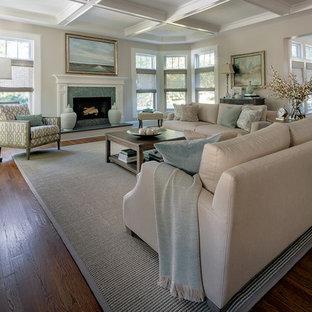 Inspiration för mycket stora klassiska separata vardagsrum, med ett finrum, beige väggar, mellanmörkt trägolv, en standard öppen spis, en spiselkrans i sten och brunt golv