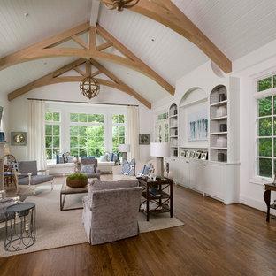 Ejemplo de salón abierto, clásico, grande, con paredes blancas, suelo de madera oscura, chimenea tradicional, televisor colgado en la pared y marco de chimenea de piedra