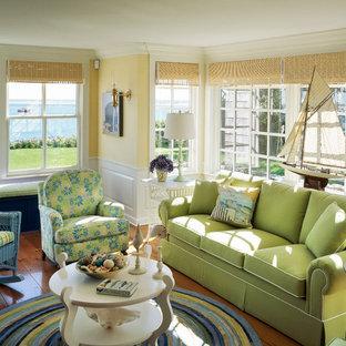 Living room - beach style medium tone wood floor living room idea in Boston with yellow walls
