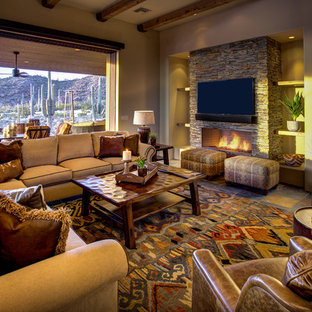 Example of a large southwest formal and enclosed slate floor and multicolored floor living room design in Phoenix with beige walls, a standard fireplace, a stone fireplace and a wall-mounted tv