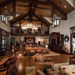 Living room - rustic dark wood floor and brown floor living room idea in Salt Lake City with white walls
