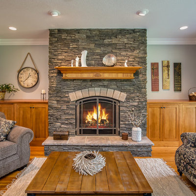 Mid-sized mountain style formal and enclosed medium tone wood floor living room photo in Atlanta with a standard fireplace, a stone fireplace and no tv