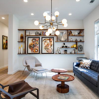 Inspiration for a large contemporary formal and open concept light wood floor living room remodel in Dallas with white walls, no fireplace and no tv