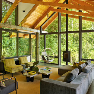 Living room - contemporary living room idea in Cleveland with no tv and a wood stove