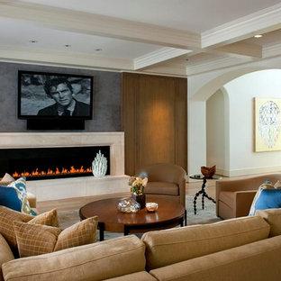 Foto de salón abierto, tradicional, grande, con paredes beige, suelo de madera clara, chimenea lineal, marco de chimenea de piedra y televisor colgado en la pared