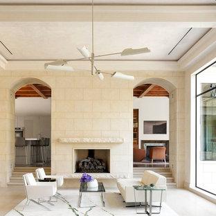 Ejemplo de salón para visitas actual con chimenea tradicional