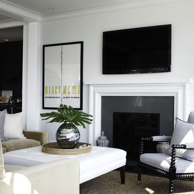 Inspiration for a transitional living room remodel in Boston with a standard fireplace and a wall-mounted tv