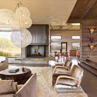 Mountain style open concept living room photo in Other with a standard fireplace