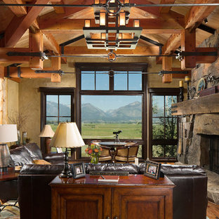 Living room - mid-sized rustic open concept and formal medium tone wood floor and brown floor living room idea in Other with beige walls, a standard fireplace, a stone fireplace and no tv