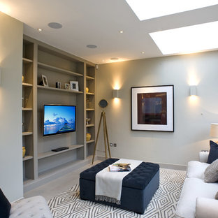 Photo of a traditional living room in London with grey walls and a wall mounted tv.