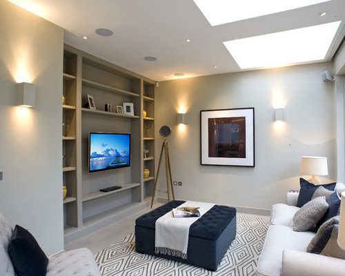 Inspiration for a transitional living room remodel in London with gray  walls and a wall-
