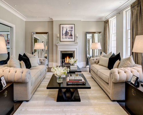 living room decorating themes. Inspiration for a transitional living room remodel in London with gray walls Living Room Decorating Themes  Houzz