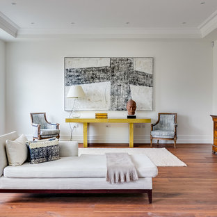 Design ideas for a contemporary living room in London with white walls, medium hardwood flooring and brown floors.