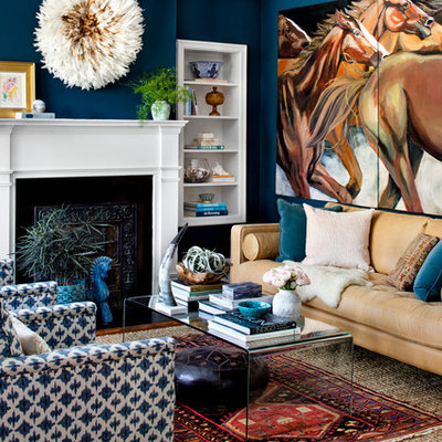 Transitional living room photo in Baltimore with blue walls and a standard fireplace
