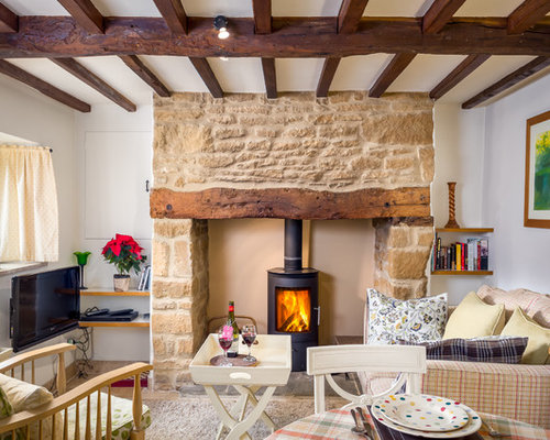 This Is An Example Of A Small Rural Enclosed Living Room In Gloucestershire  With White Walls