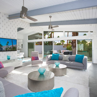 Inspiration for a huge 1950s open concept porcelain floor living room remodel in Other with white walls, a standard fireplace, a tile fireplace and a wall-mounted tv