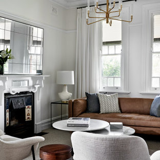 Inspiration for a mid-sized transitional formal open concept living room in Sydney with white walls, carpet, a standard fireplace, a metal fireplace surround, no tv and grey floor.