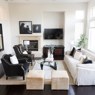 Inspiration for a traditional living room in Sacramento with white walls, dark hardwood flooring, a corner fireplace, a wall mounted tv and black floors.