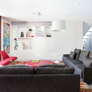 Example of a large trendy open concept and formal concrete floor living room design in Melbourne with a concealed tv and white walls