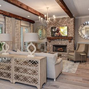 アトランタの大きいトラディショナルスタイルのおしゃれなLDK (グレーの壁、淡色無垢フローリング、標準型暖炉、レンガの暖炉まわり、壁掛け型テレビ) の写真