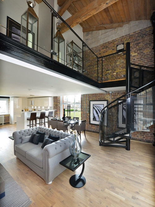 Photo Of A Large Industrial Living Room In London With Light Hardwood  Flooring, White Walls