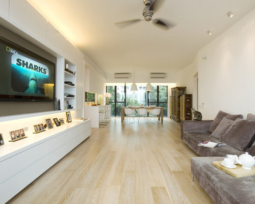 Contemporary Living Room Idea In Hong Kong With White Walls And A Media Wall