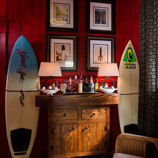 Example of a transitional living room design in Richmond with red walls and a bar