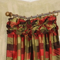 Ruched drapery Heading - Ruched silk plaid drapery panels hanging from a custom  rod.