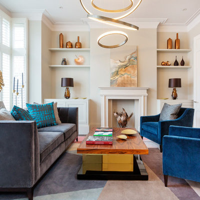 Inspiration for a mid-sized contemporary enclosed and formal living room remodel in London with a standard fireplace and beige walls