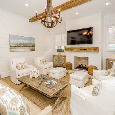 Living room - coastal living room idea in Miami with white walls and a standard fireplace