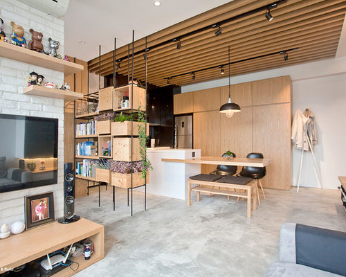 Inspiration For A Small Industrial Open Concept Concrete Floor Living Room Remodel In Hong Kong With