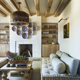 Example of a tuscan light wood floor living room design in Phoenix with a standard fireplace