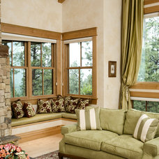 Rustic Living Room by Rocky Mountain Log Homes